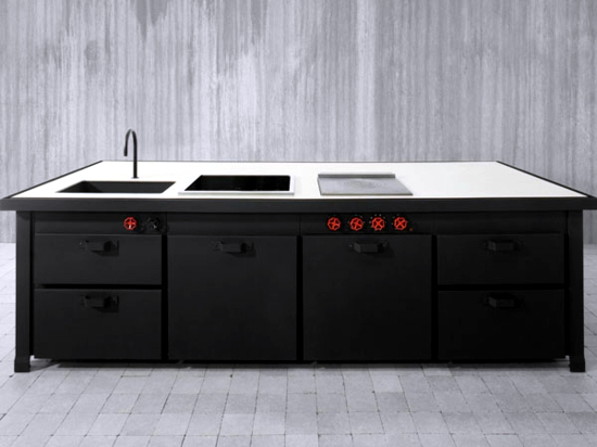 Modern fitted kitchen with cooking island brings home Italian style