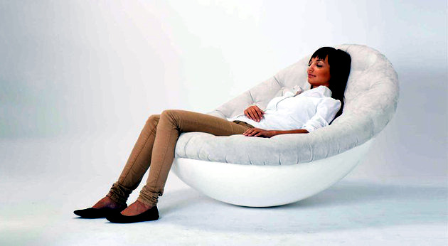 A chair has it all - a chair and a bed in another
