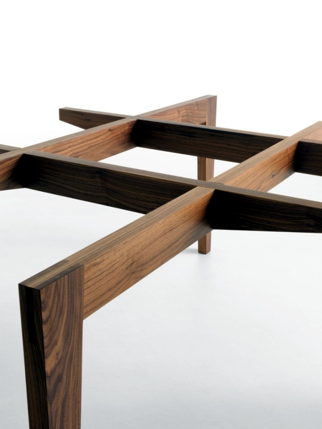 An elegant dining table design with glass and wood base Horm
