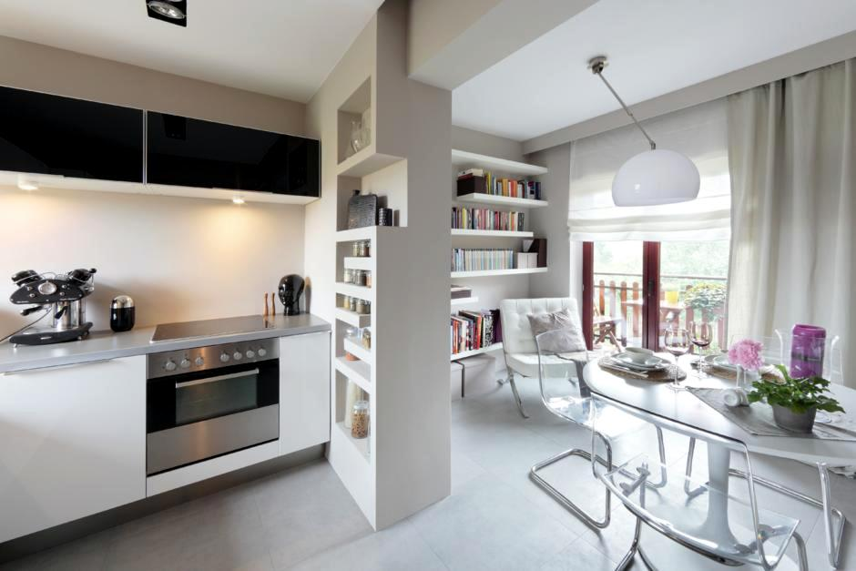 Open kitchen with transparent cantilever chairs at the ...