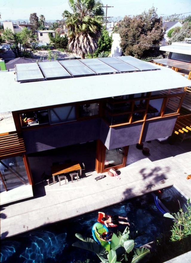 House with solar panels on the thesis of environmental awareness on the roof