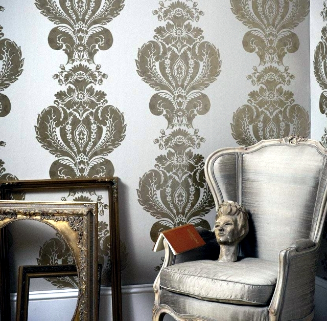 Patterned wallpaper gives the living room and modern elegance