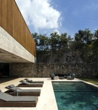 house-with-wooden-exterior-blends-in-a-rural-area-0-976
