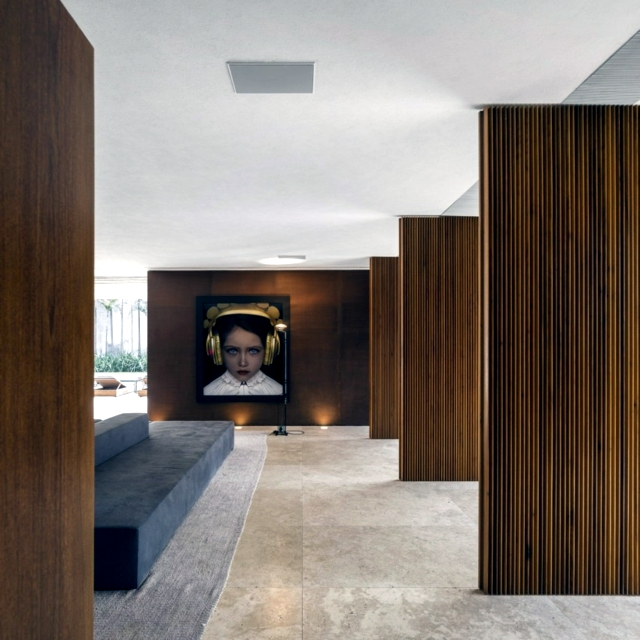 House with wooden exterior blends in a rural area