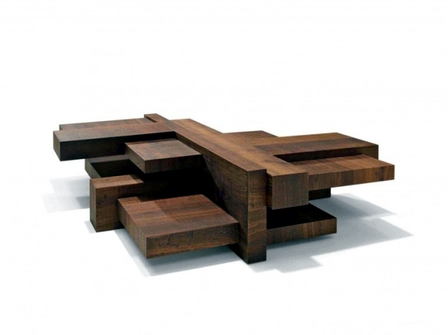 Wooden coffee table has an asymmetrical design