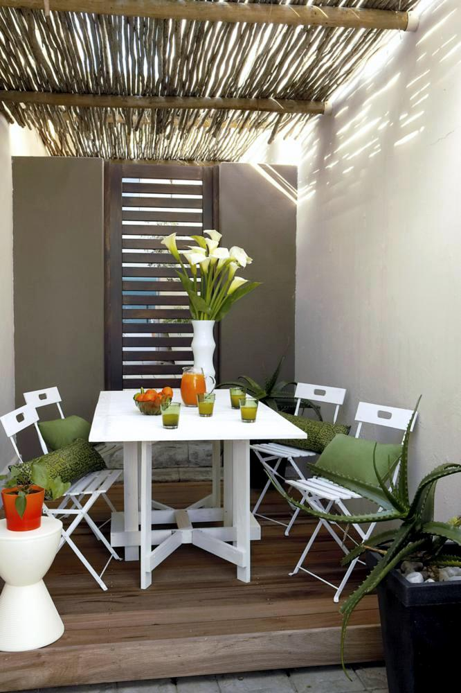 Table And Folding Chairs On Wooden Porch Interior Design