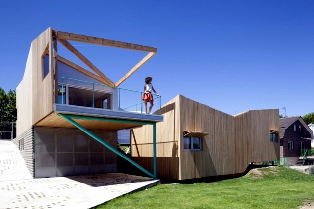 House on a hill with a seven volume modular building for House construction design