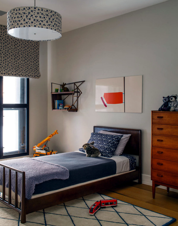 An apartment in neutral decor with splashes of color