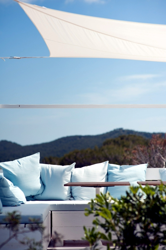 Beach in Ibiza - relax under the sun with a cocktail in hand