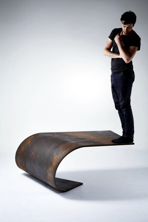 Bowed designer steel table amazed with perfect balance