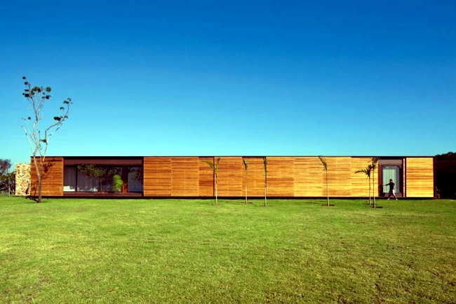 Clad Single Storey House With A Flat Roof In Brazil In