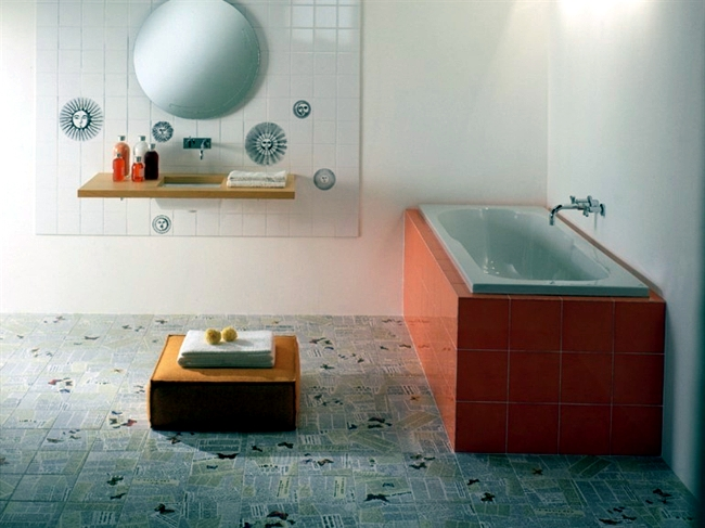 Colorful ceramic tiles with happy motifs decorate the dream bathroom