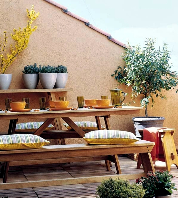 Decoration ideas for balcony table set up the patio at for Balcony wall decoration