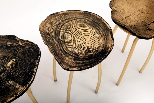 Designer chairs made of metal but with a fine grain tree trunk