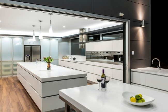 Designer Corian ® kitchen with island - Modern, open and spacious