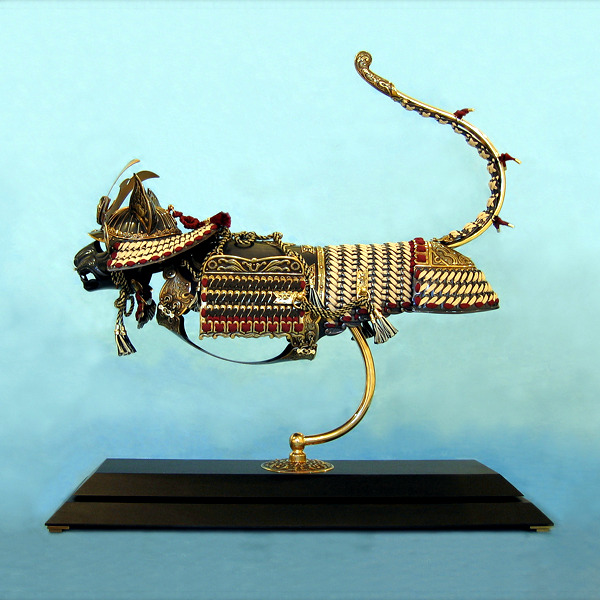Detailed art sculptures provide armor for cats and mice represent