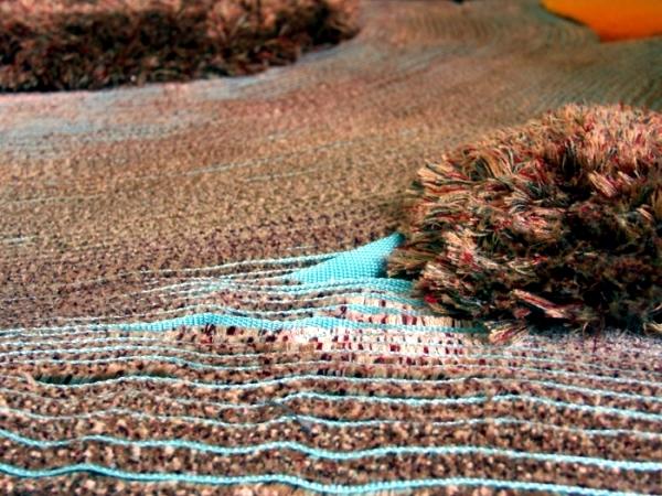 "Eccentric carpet design ""archipelago"" of Laure Kasiers"