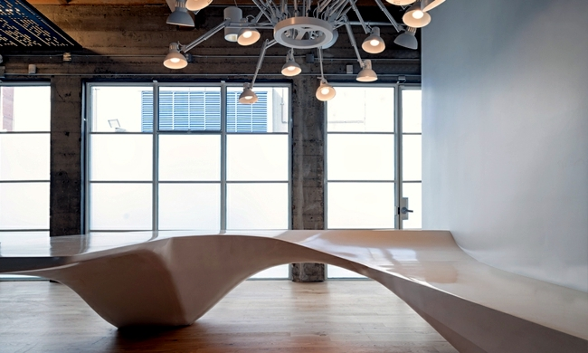 Eclectic office equipment - concrete and wood dominate the interior