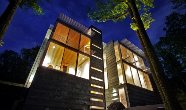 Eco house in the forest convinced by cladding with copper
