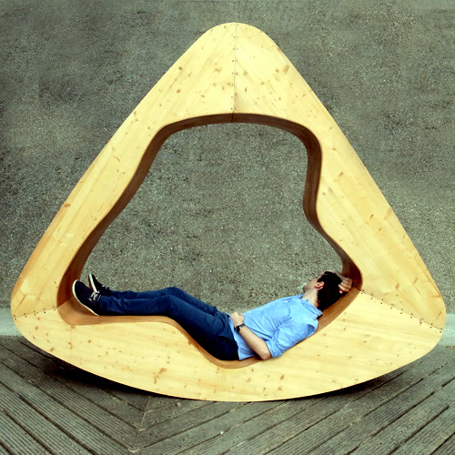 Furniture for relaxation - A wooden triangle as chair, bed and chair
