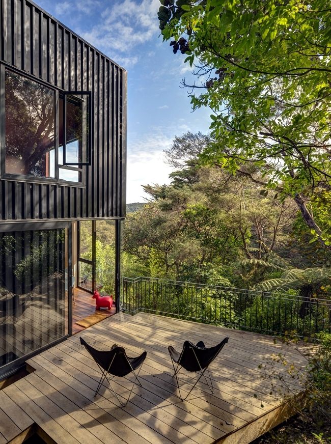 House Built On A Hillside Under A Canopy Of Shade Trees
