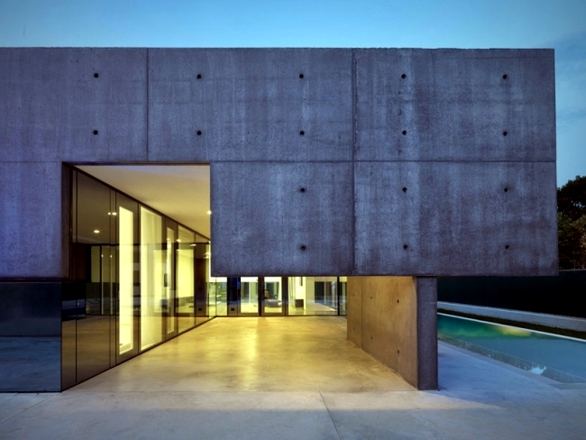 Idyllic Concrete House With Pool Provides Safety And
