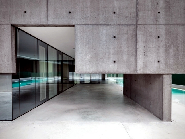 Idyllic concrete house with pool provides safety and privacy