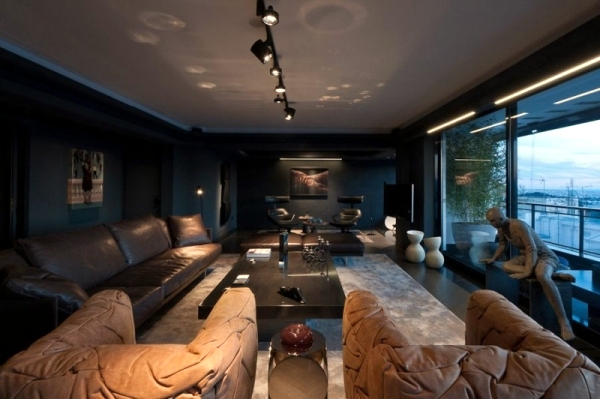 Leather furniture and works of art characterize a luxury apartment in Athens