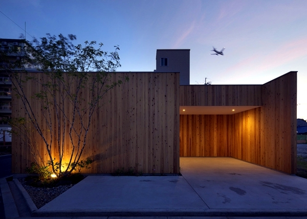 Minimalist Wooden house with a courtyard in the middle of the big city