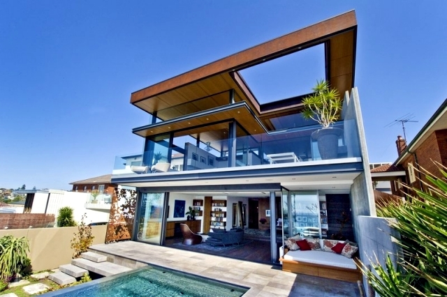 Modern beach house with glass front and a wonderful sea for Modern home front view design