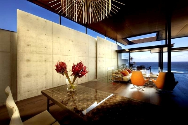 Modern beach house with glass front and a wonderful sea view