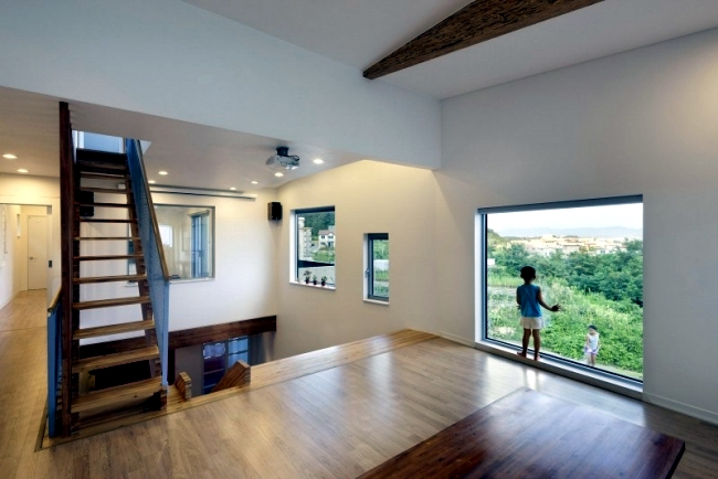 Modern detached house with an interesting interior wooden staircase