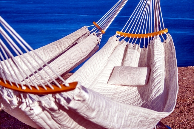 Modern hammock design ensure comfort for three persons in the garden