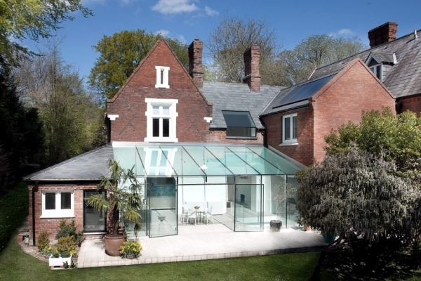 Modern House Of Glass Serves As An Attachment From The Old House In
