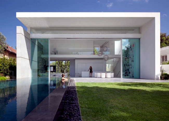 Modern Glass House Between Classes Gardening. Minimalist Architecture