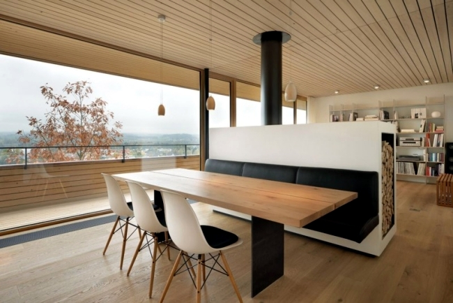 Modern house on a slope in Switzerland with mountain views