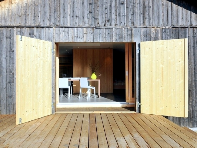 Modern log cabin in Switzerland was once old military building