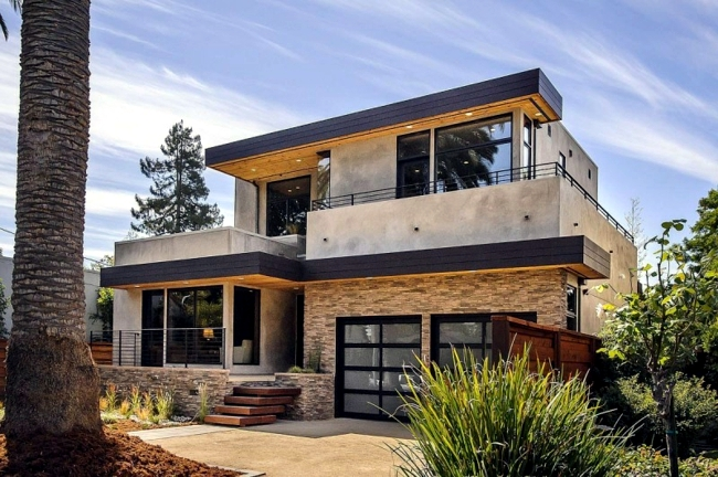 Modern massive house with stone facade and a bright interior