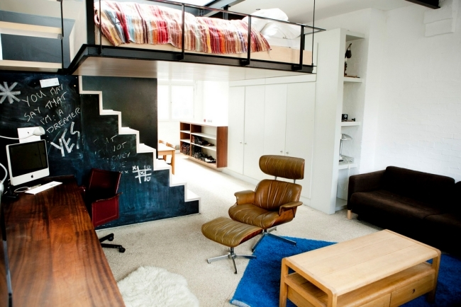 Modern studio apartment with a smart space saving concept ...