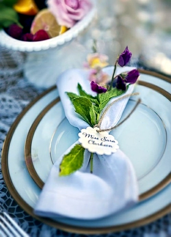 Napkin Folding beautiful table decorations in the dining room do