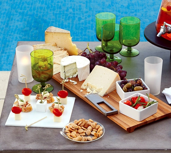 Perfect garden party-planning tablet and colorful dish as table decoration