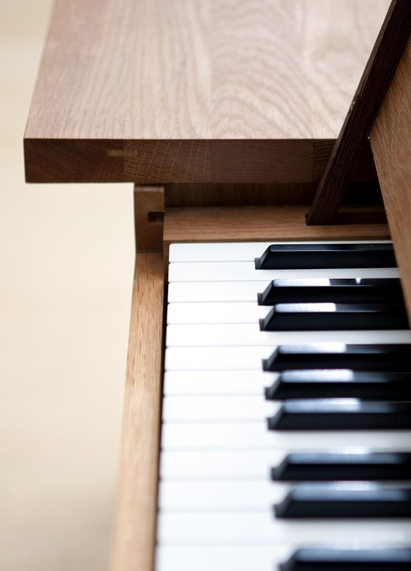 Piano Table - oak table with a hidden piano by Georg Bohle