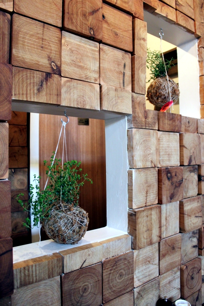 Planters made of moss and thread decorate house and Garden