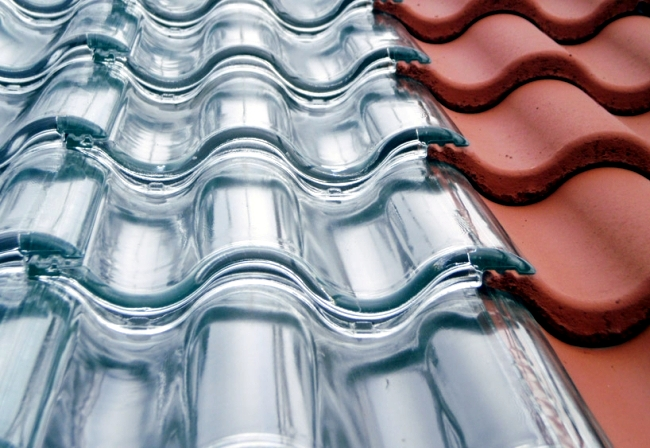 Produced tiles of glass as an effective roof system, the power
