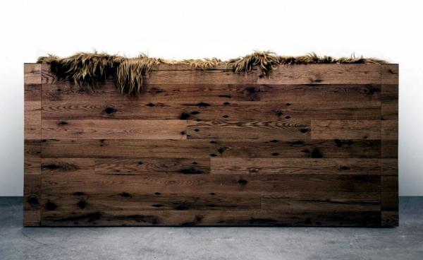 Rustic design sofa with sheepskin coating of Sentient Furniture