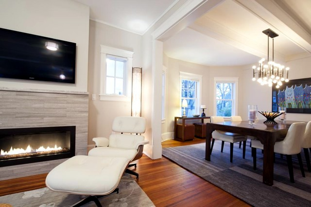 Set up the seating area in front of the cozy fireplace in the living area