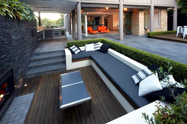 Setting up the patio area in the garden with comfortable furniture