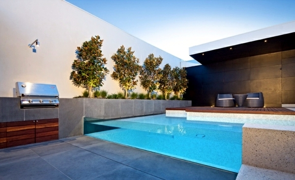 Swimming Pool With Glass Wall Creates A Relaxed Atmosphere