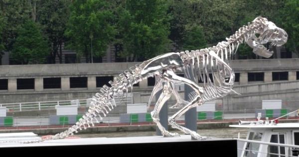Tyrannosaurus Rex watches over the Eiffel Tower modern art installation