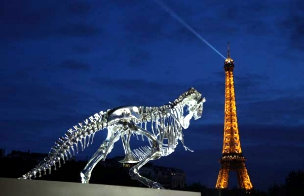 Tyrannosaurus Rex watches over the Eiffel Tower modern art installation